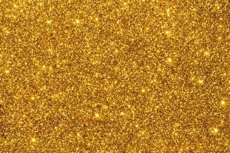 Glitter scintillanti dorati per texture o sfondo