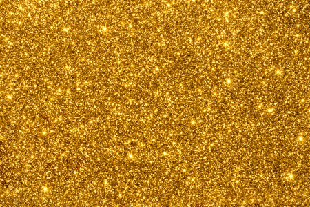 Gold shimmering glitter for texture or background