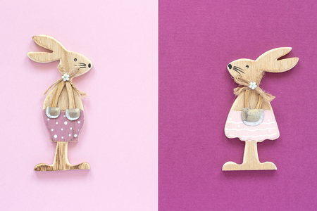 Romantic composition Pair of wooden lovers figurine rabbits on pink purple background Concept Valentines card Top view Flat Lay Copy space for text Stock Photo