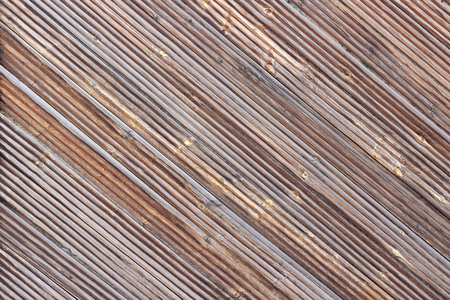 Wooden brown diagonal planks as background or texture. Imagens