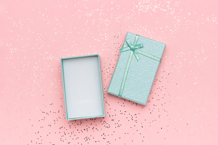 Open blue gift box with bow on pink pastel background in minimal style. Top view Copy space Mockup. 版權商用圖片
