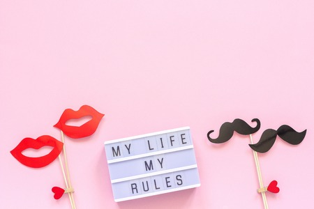 My life my rules Light box text, couple paper mustache, lips props on pink background. Concept LGBT, Homosexuality gay love National Day Against Homophobia or International Gay Day Greeting card.