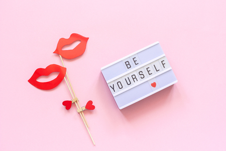 Be yourself Lightbox text, couple paper lips props on pink background. Concept LGBT, Homosexuality gay love National Day Against Homophobia or International Gay Day Top view Greeting card.