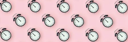 Pattern with black alarm clock on pink background. Minimal style Top view Banner Template for your text, design.