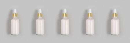Banner made with pink anti-aging collagen, facial serum in transparent glass bottle with gold pipette on grey background. Natural Organic Spa Cosmetic Beauty Concept.