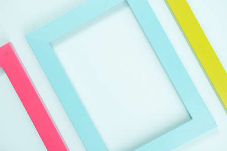Creative layout made of bright colored frames on blue background. Flat lay Top view Copy space.