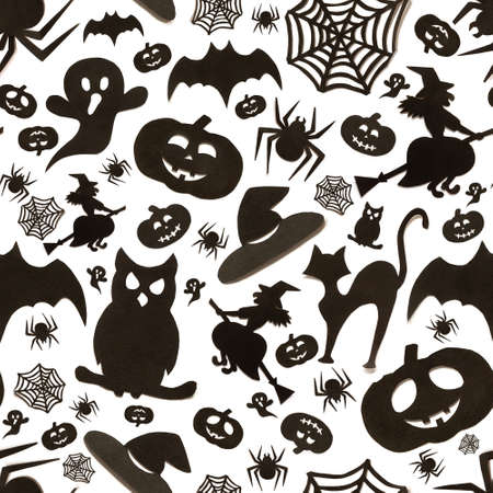 Seamless halloween pattern in cartoon style on white background. Paper art. Happy hallowen holiday concept. Zdjęcie Seryjne