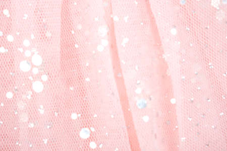Pink tulle fabric with sequins as background and texture, close-up. Zdjęcie Seryjne