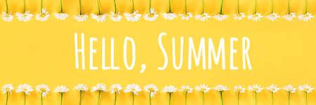 Hello Summer text and border from chamomile flowers on yellow background. Concept Welcome summer time. Banner.