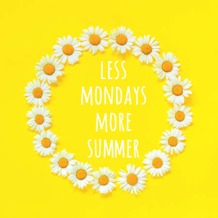 Positive motivational quote. Less mondays more summer text in frame floral round wreath of flowers chamomile on yellow background. Concept inspirational quote of the day. Banco de Imagens