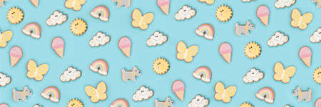Summer banner made with funny cookie gingerbread on blue background. Top view Flat lay Copy space.