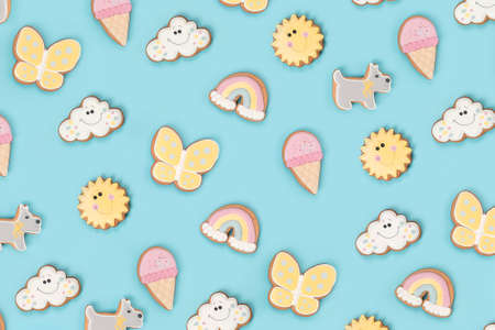 Summer wallpaper, texture made with funny cookie gingerbread on blue background. Top view Flat lay. Stock fotó