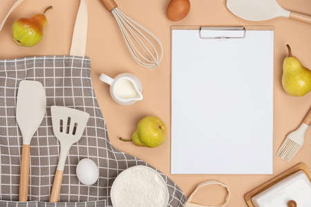 Clipboard with white paper, baking ingredients and cooking utensil, mockup. Template for cooking recipes or your design. Top view Flat lay. Stock fotó