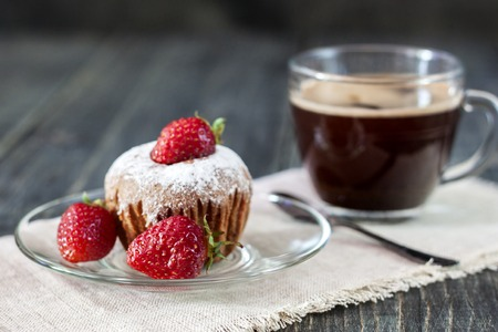 Cupcakes with fresh strawberries on a wooden table Stock Photo