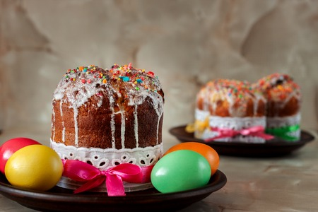 Traditional Orthodox Christian Easter food. Easter cake and painted eggs on the table.