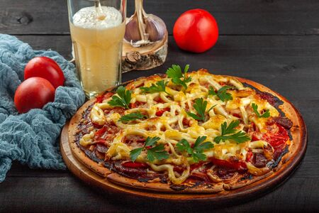 Tasty freshly baked pizza with meat, sausage, tomatoes