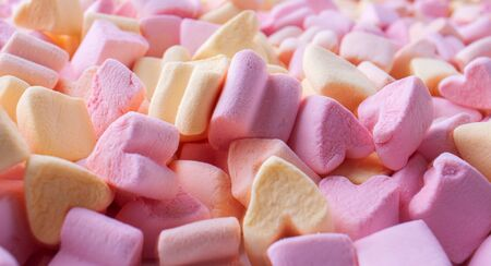 Background of multi-colored little marshmallows in the shape of hearts