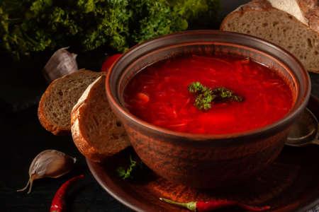 A traditional Ukrainian dish, borscht, is beet soup in earthenware.