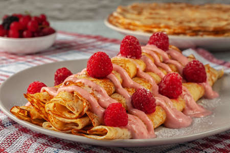 Delicious baked pancakes with yogurt and fresh raspberries