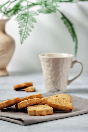 Fresh homemade cookies on a napkin on a light background