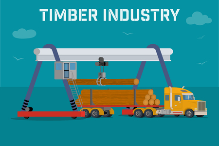 log on: Timber industry - Overhead crane loads a logs in the truck.
