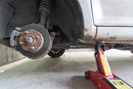 jacked: AR jack to lift car, changing car tire