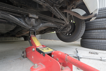 Car jack to lift car, changing car tire Stock Photo