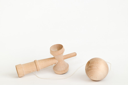 kendama is a traditional Japanese toy which consists of two wooden cups of different sizes placed on the center of a wooden spike and smaller cup with a ball connected by a string. Reklamní fotografie