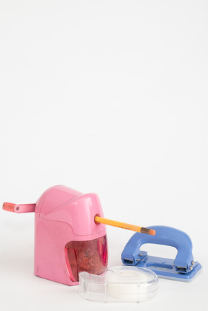hole puncher: pencil sharpener and Scotch tape and Hole puncher with copy space
