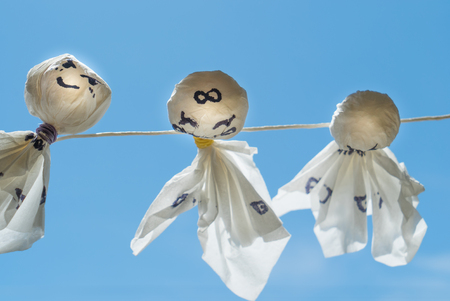 thru: Teru teru bozu is a doll made of white paper or cloth. In a Japanese custom, people believe that if you hang this doll at the eaves, it will bring good weather for the next day.