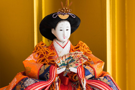 Hina ningyo is a special doll wearing a traditional Japanese costume for Dolls festival. And It is said that Hina Ningyo take away the bad luck of girls who own them. Stock Photo
