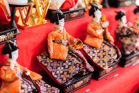 Hina ningyo is a special doll wearing a traditional Japanese costume for Dolls festival. And It is said that Hina Ningyo take away the bad luck of girls who own them. Zdjęcie Seryjne