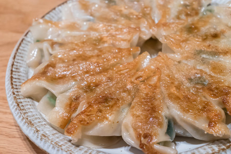 Fried Pot stickers, Dumplings, the Traditional Asian Food. '' gyoza' '