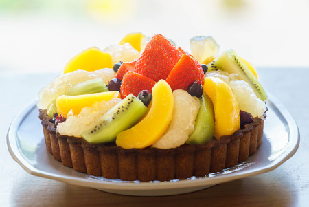 Fresh fruit tart on cake