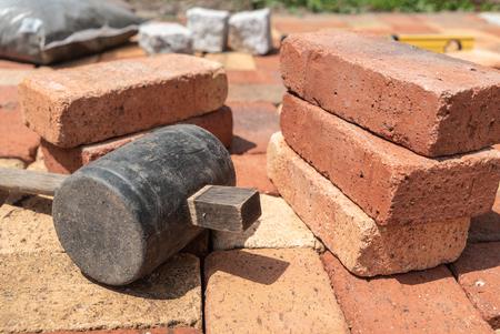 close-up biricks and hammer. laying bricks tool.