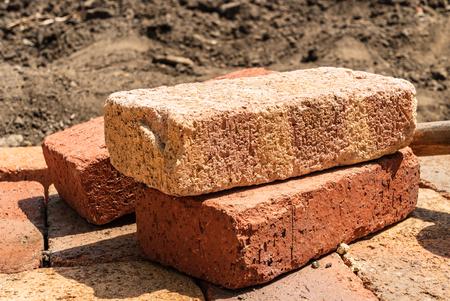 Close-up bricks. Laying bricks to make a floor