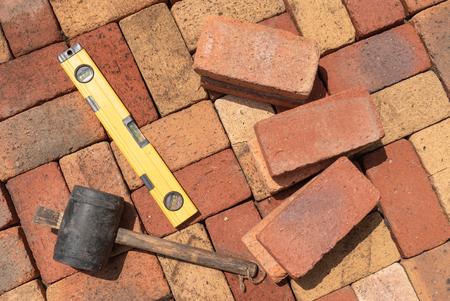 Hulpmiddel voor bakstenen vloeren Stockfoto