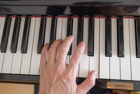 man hands on the keys of the piano Standard-Bild