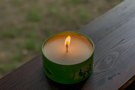 Candle on a desk Foto de archivo - 150556415