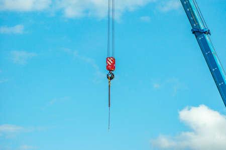 arrow and hook of the crane againsy blue sky Stock fotó