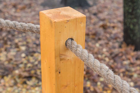 wooden pole with a rope