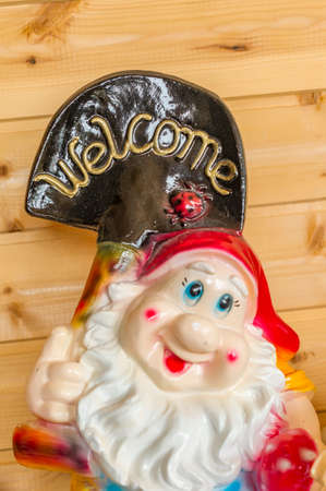 Decorative gnome with sign