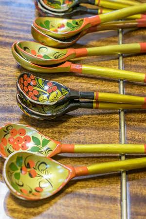 Khokhloma spoons on wooden table Stock Photo