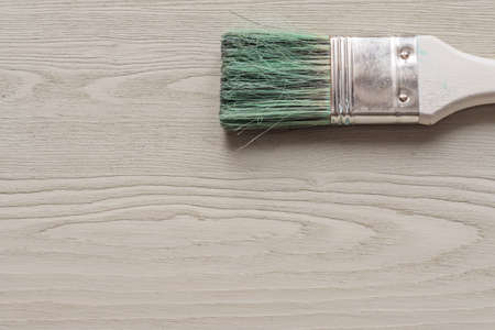painted wooden desk and brush