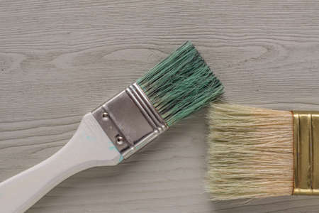 painted wooden desk and brushes