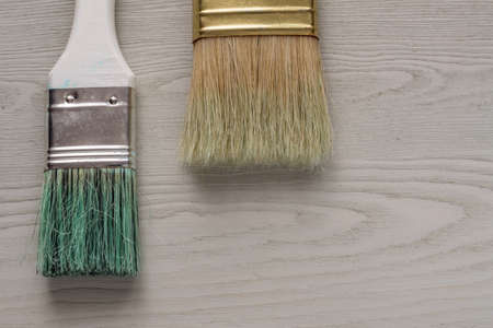 painted wooden desk and two brushes