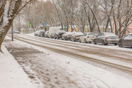 Moscow, Russia - February 1, 2018: Parked cars covered with snow - snow storm