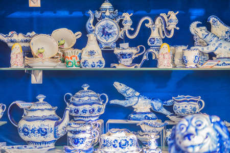 MOSCOW, RUSSIA - JANUARY 10, 2018: Colorful porcelain utensils and souvenirs in gzhel style at market. Traditional russian souvenir