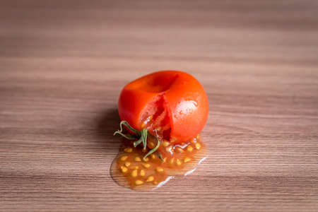 smashed tomato on wooden table