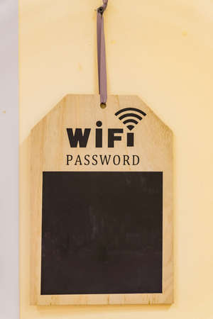 wooden desk for wifi password on the wall